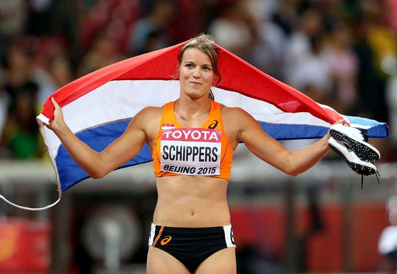 BEIJING, CHINA - AUGUST 24: Dafne Schippers of the Netherlands celebrates after winning silver in the Women's 100 metres final during day three of the 15th IAAF World Athletics Championships Beijing 2015 at Beijing National Stadium on August 24, 2015 in Beijing, China. (Photo by Alexander Hassenstein/Getty Images for IAAF)